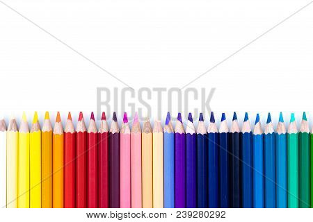 Close Up Seamless Colored Pencils Row Isolated On White Background. Colorful Pencils With Copy Space