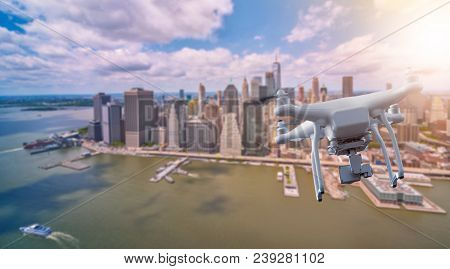 multicopter drone flying over the lower part of Manhatten, New York City, Manhattan