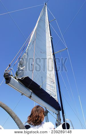 Views Of The Mast, Sails And Rigging On The Private Sail Yacht With Girl Woman Yachting Concept Mari