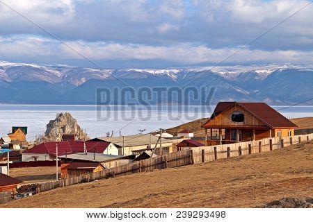 Khuzhir City With Shamanka Rock And Beautiful Mountainious Behind Baikal Lake In Late Winter