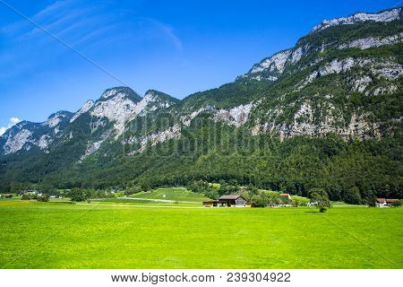 Dolomites Apls, Switzerland Panorama. Dolomites Alps Landscape, Green Valley With High Mountains And