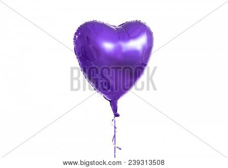 holidays, valentines day and party decoration concept - close up of inflated helium heart shaped balloon over white background