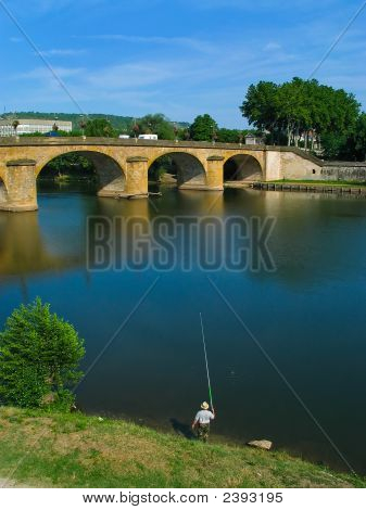 View of a fisherman fishing in river