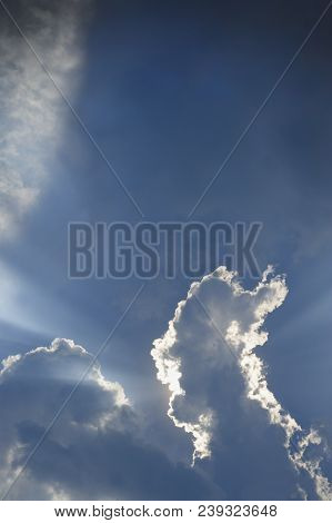 Light In The Clouds On Blue Sky