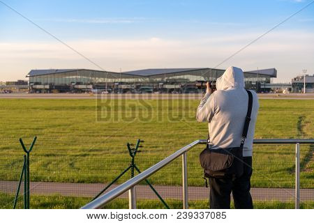 Gdansk, Poland - May 5, 2018: Plane Spotter Photographer Taking Photos Of Airplanes At Lech Walesa A