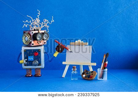 Kindly Robot Artist Begins To Create A Drawing With A Pencil. White Paper Template, Wooden Easel And
