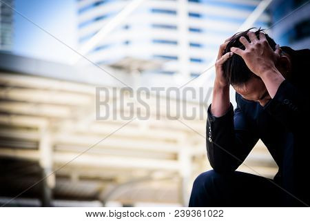 Asian Businessman Feel Sad And Frustrated Upset Fail In Life.