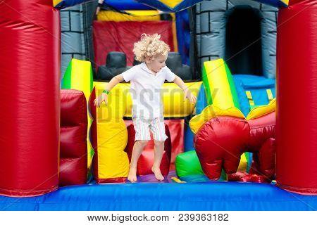 Child Jumping On Playground Trampoline. Kids Jump.