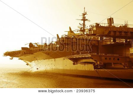 Aircraft carrier in the ocean at sunset poster