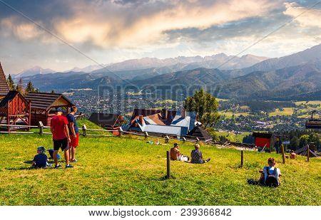 Tourist Observe High Tatra Mountains. Beautiful Location In Zakopane Village, Poland