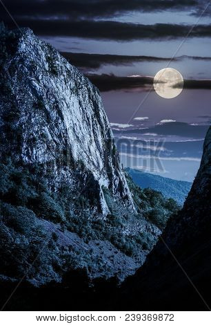 Cliffs Of Trascau Mountains Canyon At Night In Full Moon Light. Lovely Scenery Of Carpathian Landsca