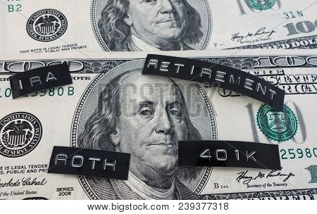 401k, Roth, Ira And Retirement Labels On Hundred Dollar Bill
