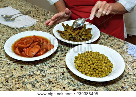 Bowls Of Green Beans, Yams And Peas, Being Prepared To Be Served At A Christmas Dinner.