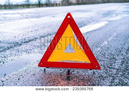 Red Emergency Stop Sign On The Road. Warning Triangle On Asphalt Road. Emergency Stop Concept.