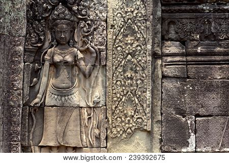 Carved Stone Bas-relief Of Angkor Wat Complex Temple, Siem Reap, Cambodia. Historical Site Of Khmer