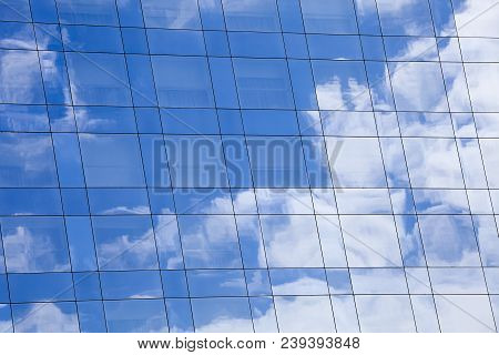 Facade Glass Windows With Sky Reflected And Architecture Of A Modern Office Building, Construction B