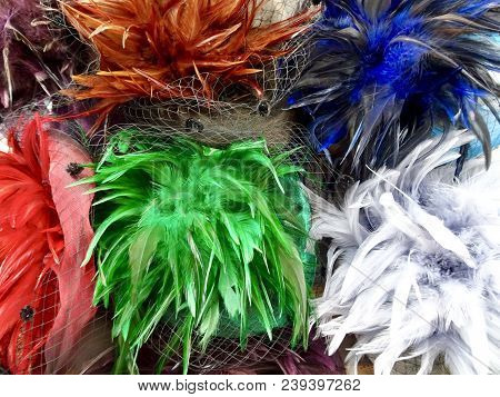 Vibrant Colors Of Feathers And Netting Of Hats Suitable For Kentucky Derby Attendance Attire.  Close