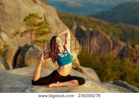Gorgeous Young Woman Doing Yoga Outdoors Stunning Landscape On The Background. Athletic Woman Practi