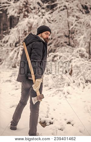 Bearded Man With Axe In Snowy Forest. Man Lumberjack With Ax. Camping, Traveling And Winter Rest. Sk