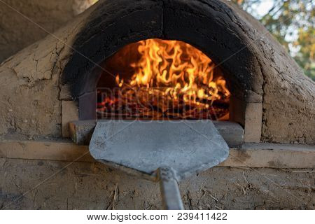 Pizzas Cooking In Stone And Cob Pizza Oven. Traditional Cooking Scene, Background