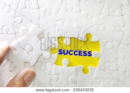 Close Up Piece Of White Jigsaw Puzzle With Success Text , Concept Of Business Challenge Success Comp