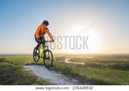 Mountain Bike Cyclist Riding Single Track Outdoor. The Concept Of Extreme Sports.