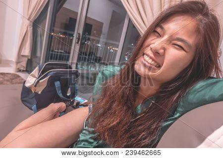 Smile Sexy Asian Woman In Pyjamas On Sofa