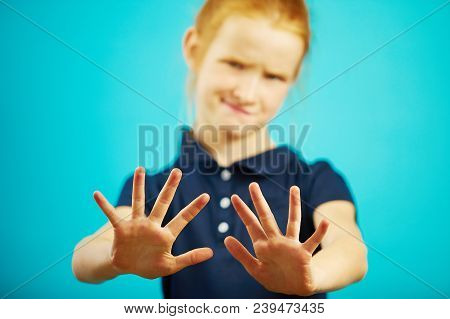 Child expresses denial by pulling his hands into the camera, showing repulsion or rejection. Squeamish girl doesn't want to get anything. poster