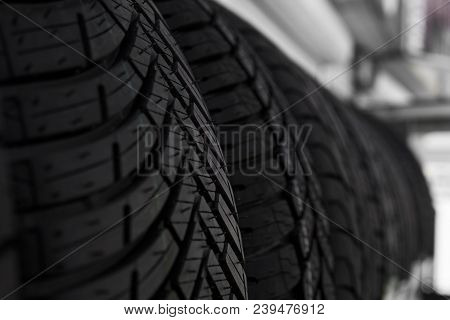 Protector Of Automobile Tires. A Number Of Automobile Tires. Close Up View On Auto Mobile New Wheel