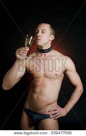 Sexy Guy In The Collar. Guy With A Beautiful Body Drinking Champagne. Collar And Adult Games.