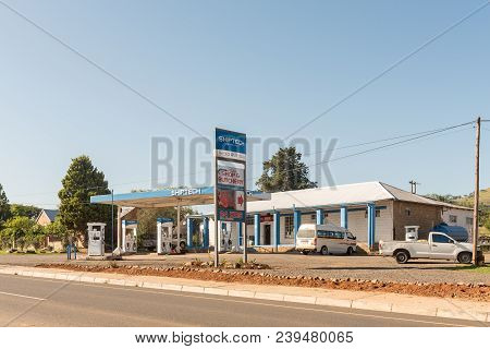 Estcourt, South Africa - March 21, 2018: A Street Scene With Gas Station, Shop And Vehicles At Moorl