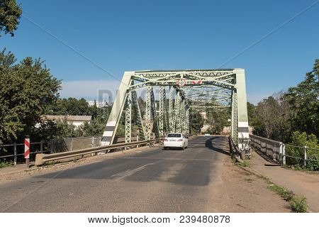 Estcourt, South Africa - March 21, 2018: A Car Crossing The Historic Steel Road Bridge Over The Bush