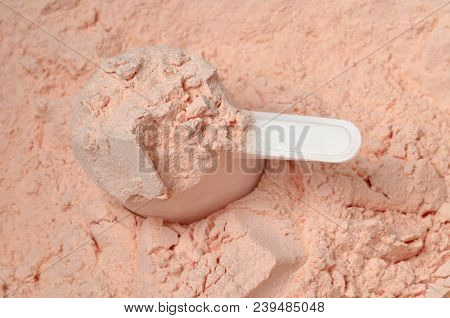 Strawberry Protein Powder In A Measuring Cup