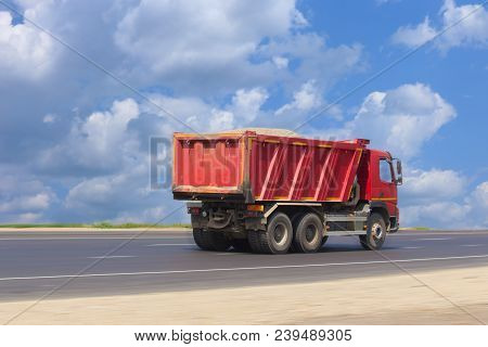 Big Dump Truck Goes On Highway Photo