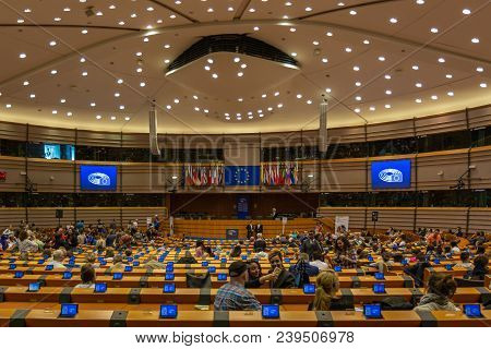 Brussels, Belgium - May 5, 2018 : People Visiting The Interior Of The European Parliament Hemicycle