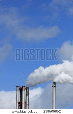 Chimneys and smokestacks of an industrial plant, Chemical industrial industry poster