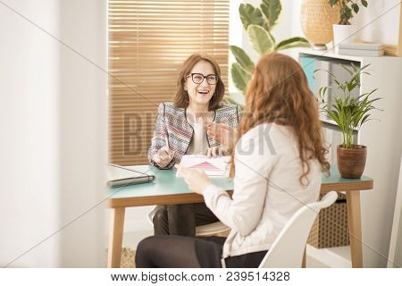 Smiling Corporate Advisor Supporting Employee