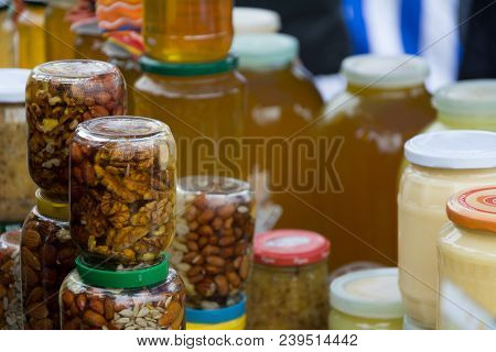 Walnuts With Honey, Sunflower Seeds With Honey In A Glass Jar