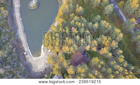 A Little House Near A Pond, Surrounded By Trees And Grass. Video. Top View Of The Pond In The Woods