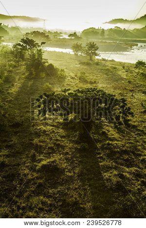 Hermoso amanecer en la montaсa junto al rio poster