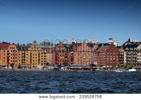 Stockholm, Sweden - July 2014: Waterside Settlement Full Of Iconic Buildings At Port Of Kungsholmsto