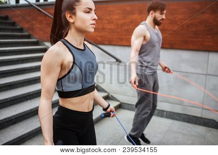 Two Strong People Are Jumping Using A Rope For That. Guy Is Jumping More Intensive That Girl Does. H