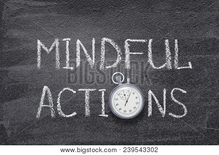 Mindful Actions Phrase Handwritten On Chalkboard With Vintage Precise Stopwatch Used Instead Of O