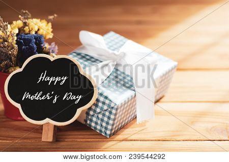 Happy Mother's Day Concept. Gift Box With Flower, Wooden Tag With Happy Mother's Day Text On Wooden
