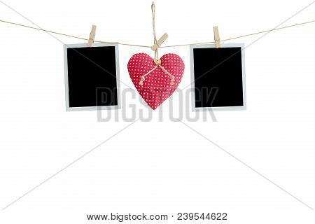 Blank Instant Photos And Red Heart Hanging On Isolated White With Clipping Path.