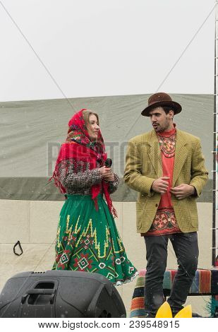 Tiraspol, Moldova - February 18: Man And Woman In Scenic National Costumes At The Pancake Week. In T