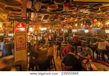 Brussels, Belgium - Apr 2: Women And Men Drinking Alcohol Inside The Old Bar Delirium With Retro Fur