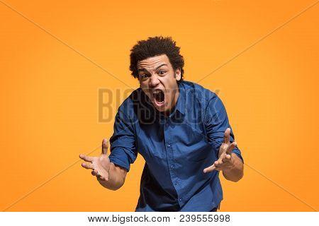 Screaming, Hate, Rage. Crying Emotional Angry Afro Man Screaming On Orange Studio Background. Emotio