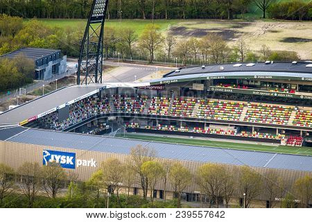 Silkeborg, Denmark - May 5 - 2014: Silkeborg Stadium Seen From The Air With Colorful Seats And No Pe