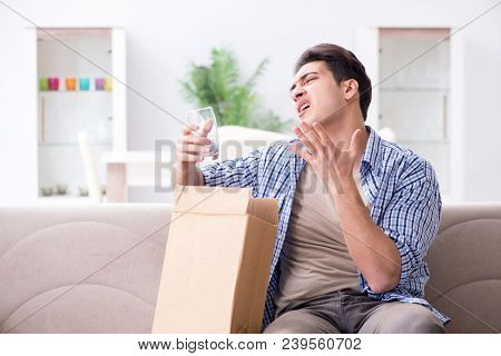 Man receiving wrong parcel with glasses